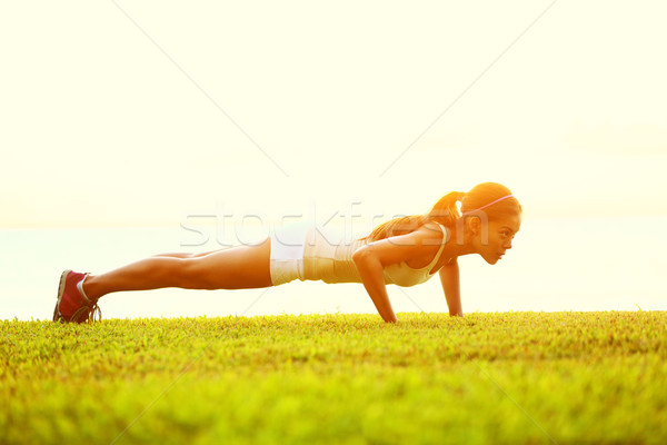 push ups or press ups exercise by young woman Stock photo © Maridav