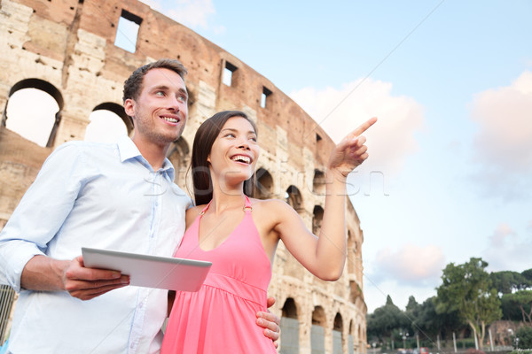 Happy travel couple with tablet by Coliseum, Rome Stock photo © Maridav