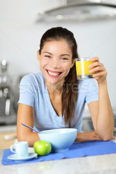 Woman drinking orange juice eating breakfast Stock photo © Maridav