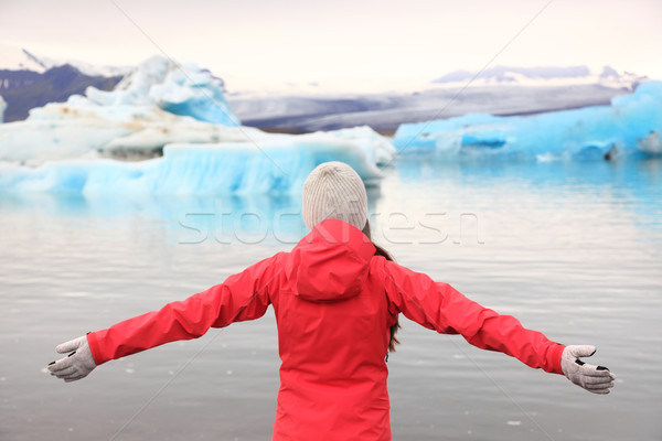 Freedom happy woman at glacier lagoon on Iceland Stock photo © Maridav