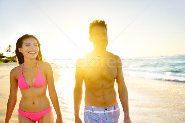 Beach Lifestyle Couple Walking on Beach at Sunset Stock photo © Maridav