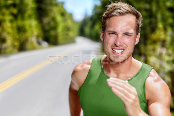 Athlete runner on intense cardio running workout Stock photo © Maridav