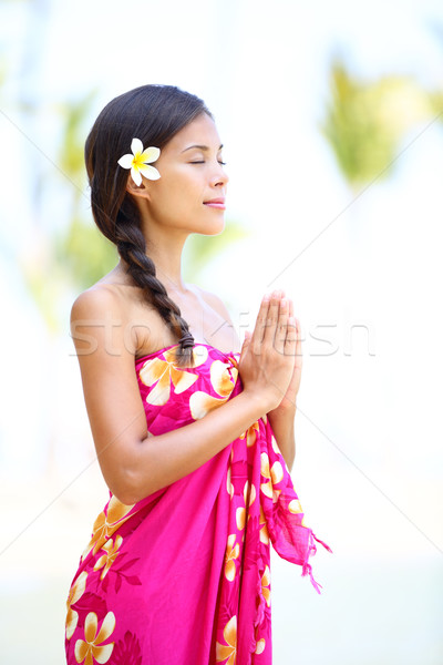 Meditating spiritual woman in meditation on beach Stock photo © Maridav