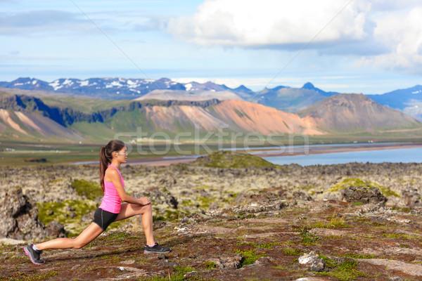 Fitness girl doing lunges exercise in nature Stock photo © Maridav