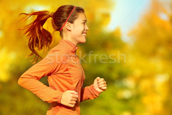 Stock photo: Woman runner running in fall autumn forest