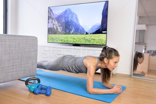 Living room exercises - girl doing plank at home Stock photo © Maridav