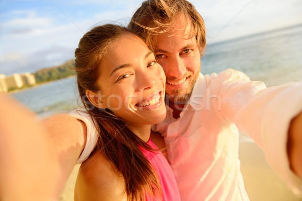 Happy couple taking fun selfie on summer vacation Stock photo © Maridav