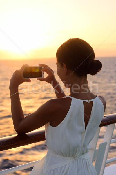 Cruise ship vacation woman taking photo with phone Stock photo © Maridav
