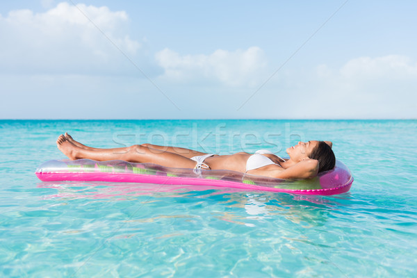 Beach woman relaxing sunbathing floating on ocean Stock photo © Maridav