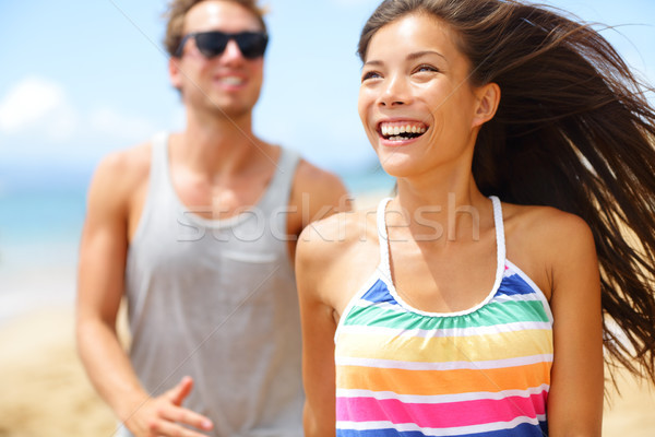 Young happy couple laughing having fun on beach Stock photo © Maridav