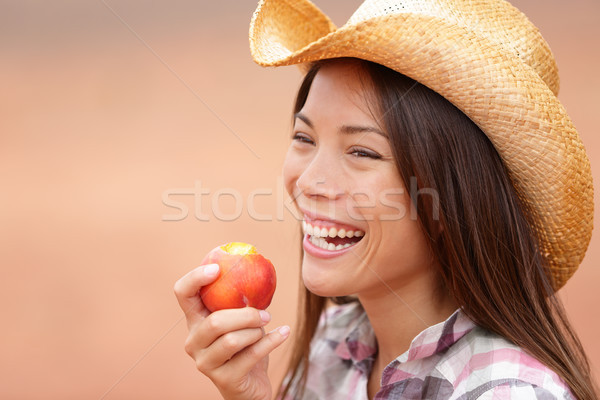 American cowgirl eating peach Stock photo © Maridav