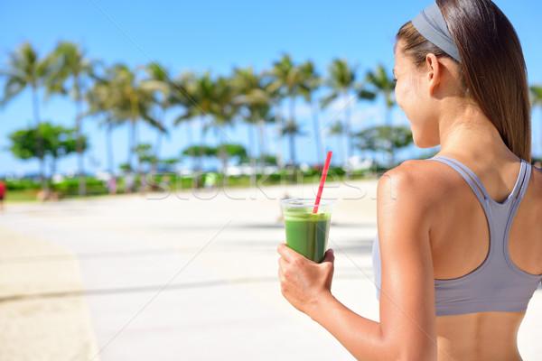 Stock photo: Woman drinking vegetable Green detox smoothie