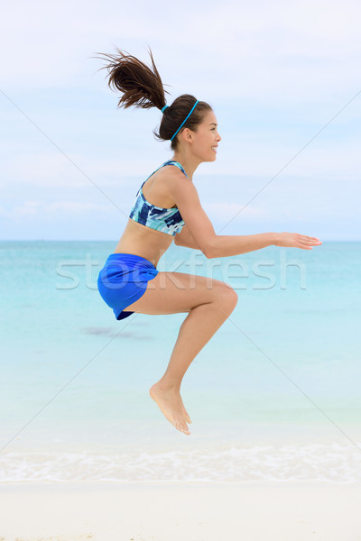 Crossfit woman doing jump squat training exercises Stock photo © Maridav
