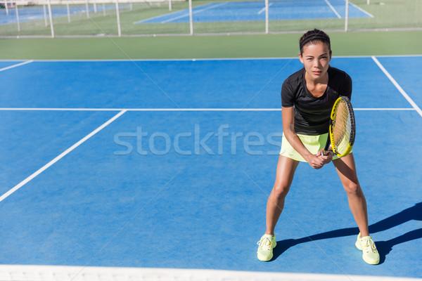 Asian tennis player woman ready to play on court Stock photo © Maridav
