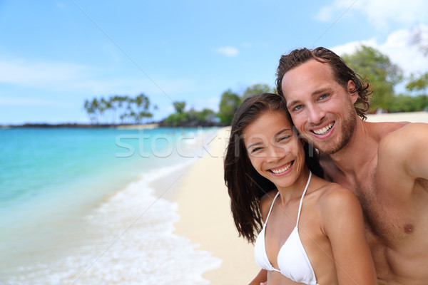 Happy couple selfie on exotic beach vacation Stock photo © Maridav