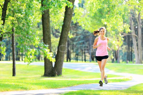 Jogging kobieta uruchomiony parku słońca piękna Zdjęcia stock © Maridav