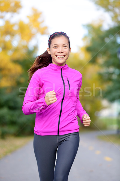 Running sport woman training in fall autumn forest Stock photo © Maridav