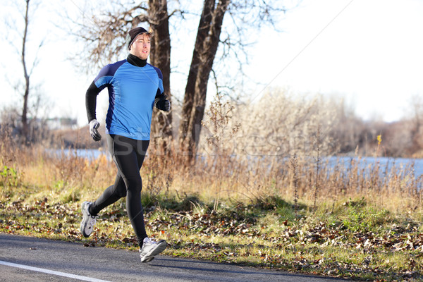 Male runner man running in autumn on cold day Stock photo © Maridav