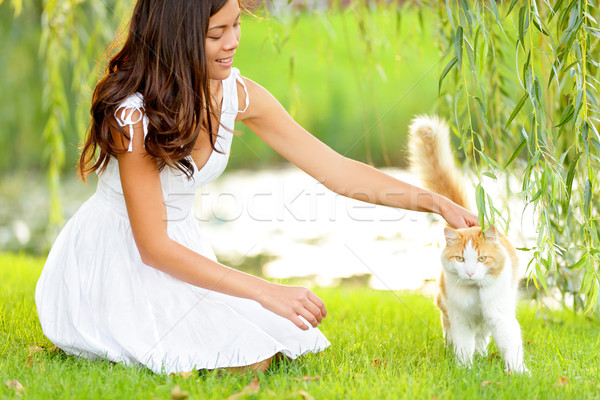 Woman petting cat in summer park Stock photo © Maridav