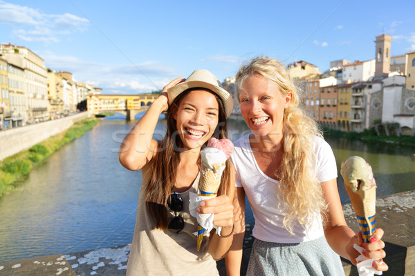 Happy women friends eating ice cream in Florence Stock photo © Maridav
