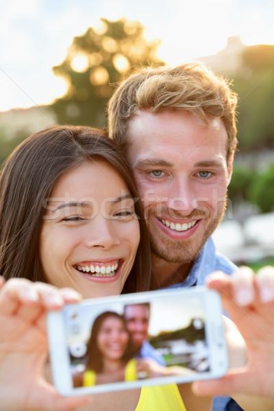 Couple in love taking selfie photo with smartphone Stock photo © Maridav