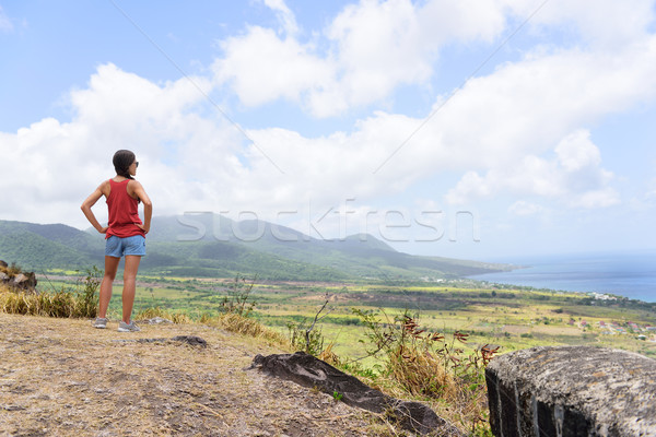 Hiking travel woman looking at St Kitts landscape Stock photo © Maridav