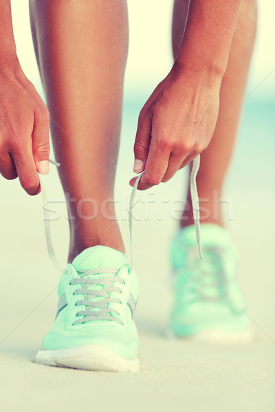 Active life runner girl tying running shoes laces Stock photo © Maridav
