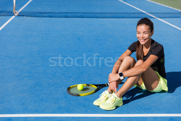 Stock photo: Tennis player woman wearing sports smartwatch