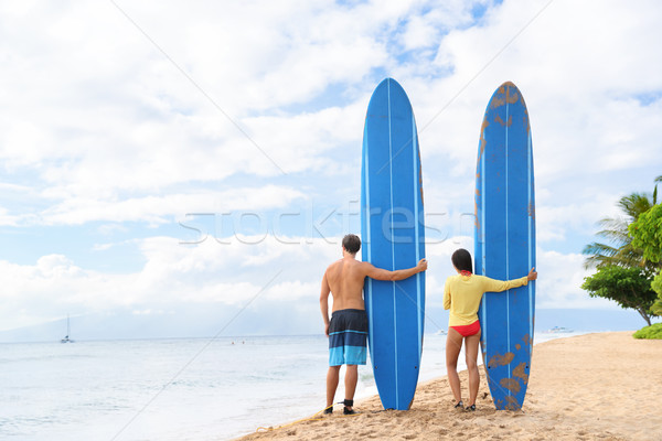 Two people standing with surfboars at beach Stock photo © Maridav