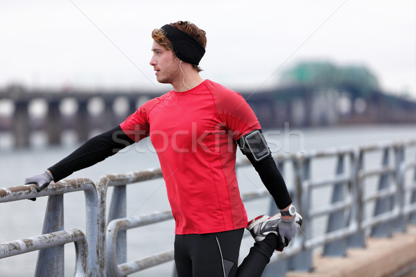 Male runner training in cold winter doing warm-up Stock photo © Maridav