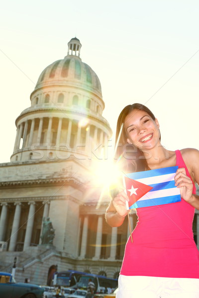 Havana, Cuba - Capitol and tourist with cuban flag Stock photo © Maridav