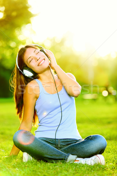 Woman listening to music Stock photo © Maridav
