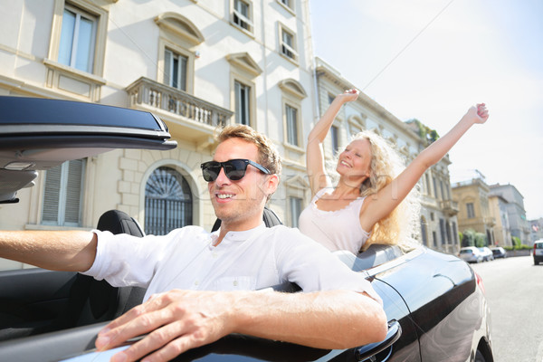 Car people - man driving with happy woman Stock photo © Maridav