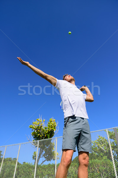 Tennis player serving playing outdoors - sport man Stock photo © Maridav