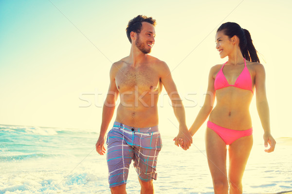 Couple holding hands together at beach sunset Stock photo © Maridav