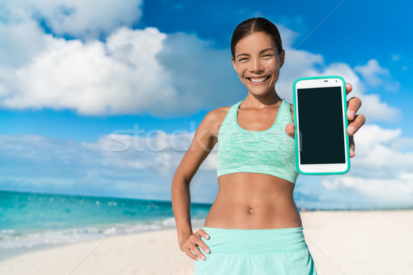 Runner girl using smartphone fitness app  Stock photo © Maridav