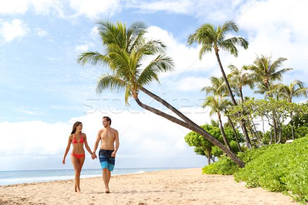 Hawaii holiday couple walking on Maui beach Stock photo © Maridav