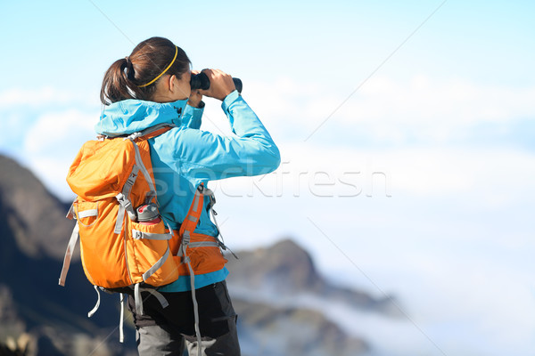 Stock photo: Hiker looking in binoculars