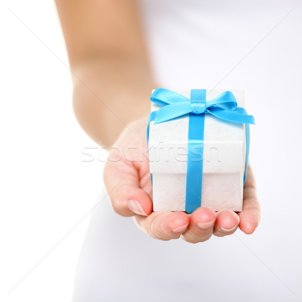 Gift box / present or christmas gift hand close up Stock photo © Maridav