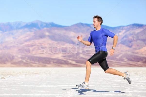 Man running outdoor sprinting for success Stock photo © Maridav