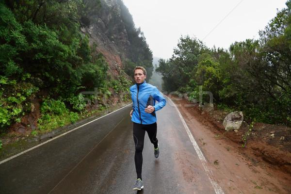 Male runner jogging and running on road in nature Stock photo © Maridav