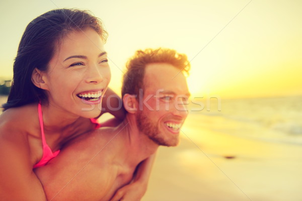 Happy beach fun multicultural couple - summer love Stock photo © Maridav
