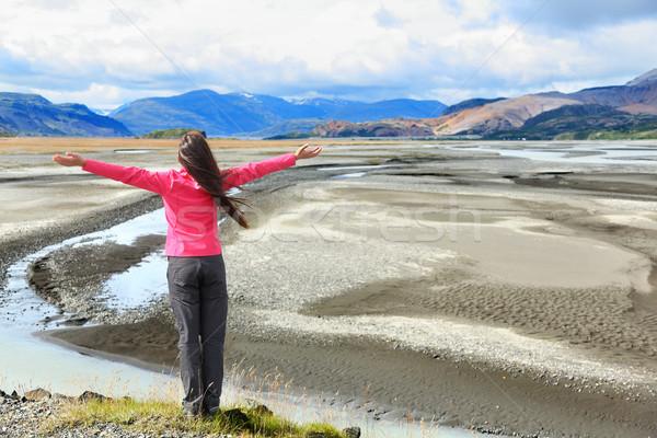 Woman enjoying view of Iceland black sand dunes Stock photo © Maridav