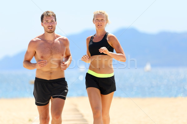 Fitness courir couple cardio plage Photo stock © Maridav