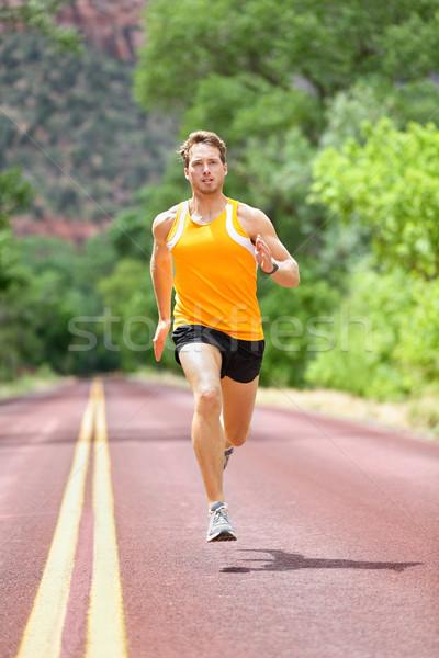 Full Length Of Determined Man Running On Road Stock photo © Maridav