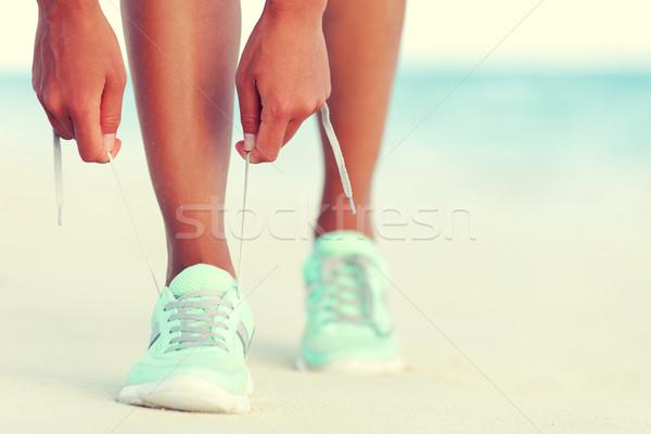 Healthy active lifestyle girl tying running shoes Stock photo © Maridav