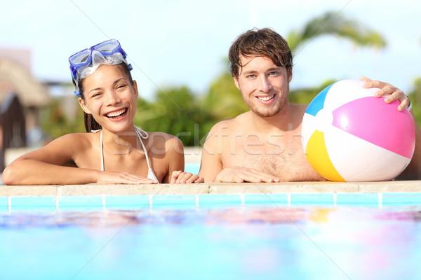 Nyári vakáció pár szórakozás medence napos idő trópusi Stock fotó © Maridav