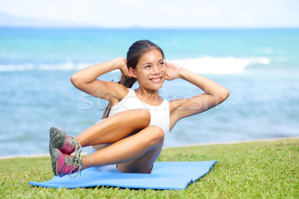 Stock photo: Fitness woman exercising sit ups outside