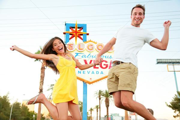 Las Vegas signe heureux couple sautant personnes Photo stock © Maridav