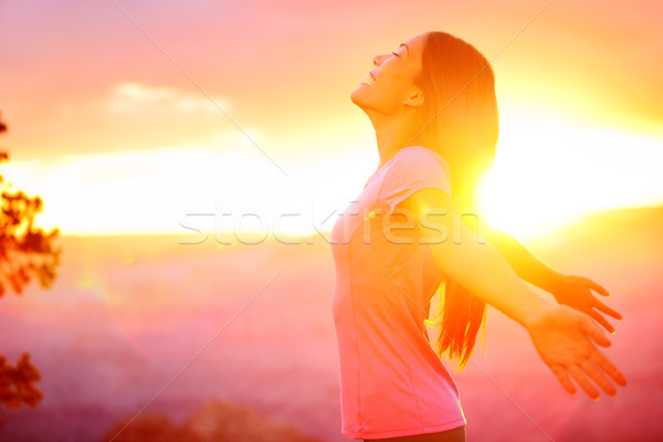 Free happy woman enjoying nature sunset Stock photo © Maridav